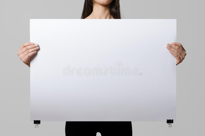 Woman holding a blank poster. royalty free stock photos