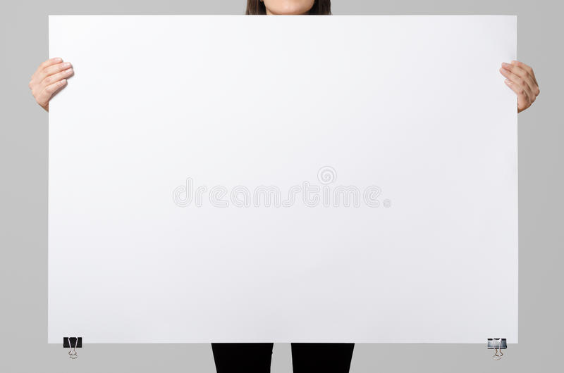 Woman holding a blank poster. royalty free stock images