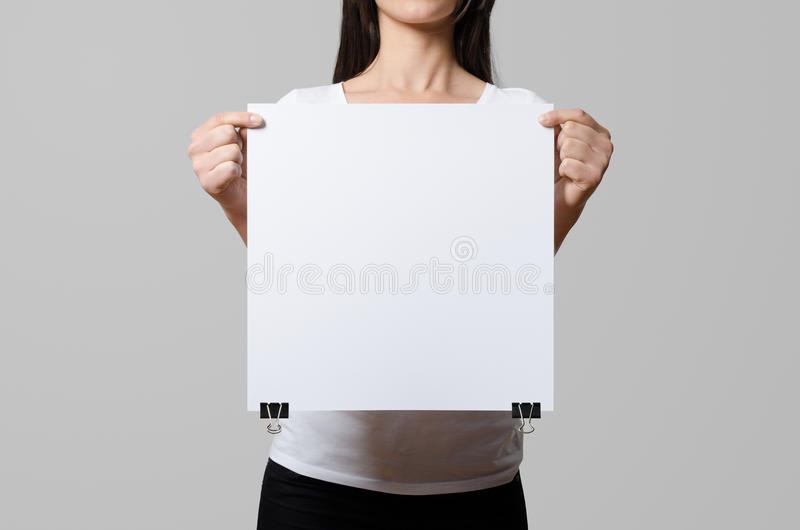Woman holding a blank poster. stock photo