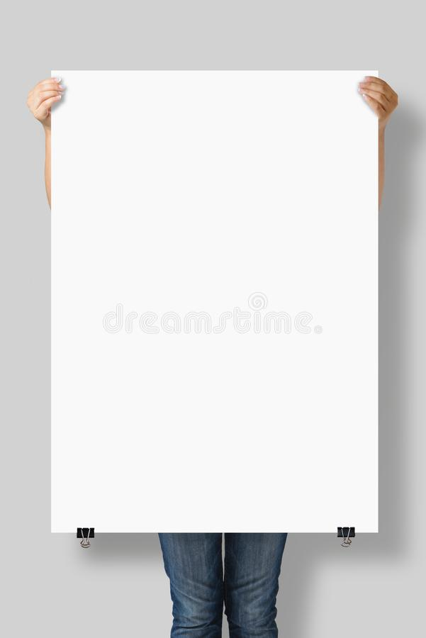 Woman holding a blank A0 poster mockup. royalty free stock photography