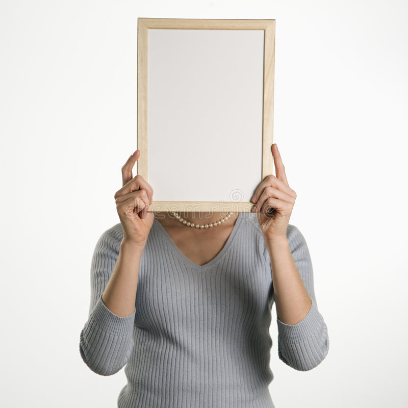 Woman holding blank sign. royalty free stock images