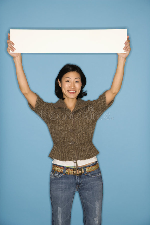 Woman holding blank sign. royalty free stock photos