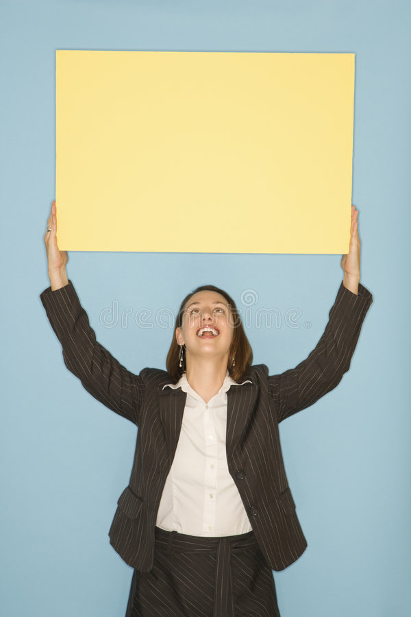 Woman holding blank sign. royalty free stock photography