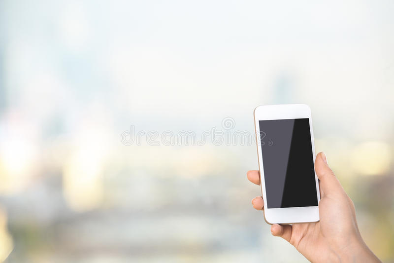 Woman holding blank smartphone stock photo
