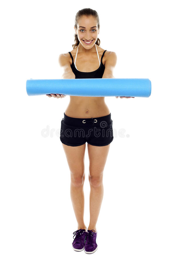 Download Woman Holding A Blue Mat In Her Outstretched Arms Stock Image - Image: 27847537