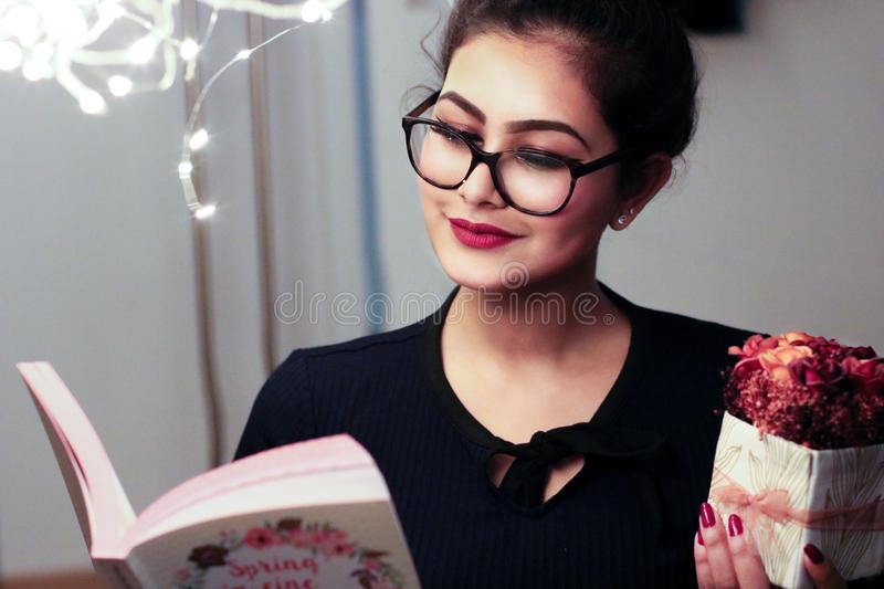 Woman Holding Book stock photo