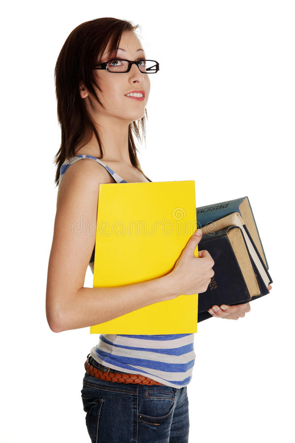 Woman holding books and folder