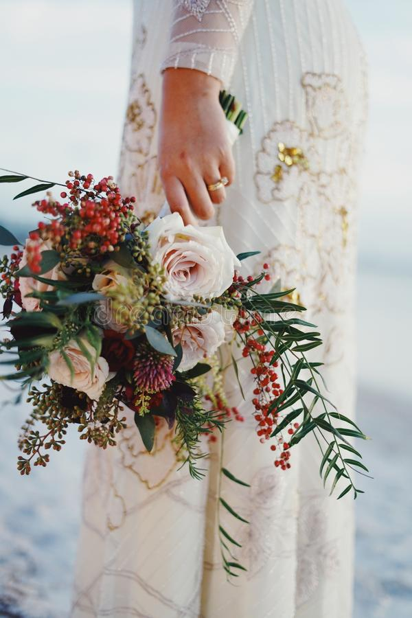 Woman Holding Bouquet of Flowers stock images