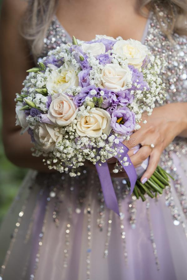 Woman holding a bouquet of flowers stock photo