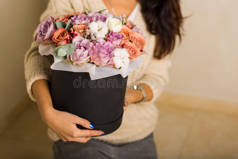 Woman holding a bouquet. Woman holding a gorgeous bouquet royalty free stock image