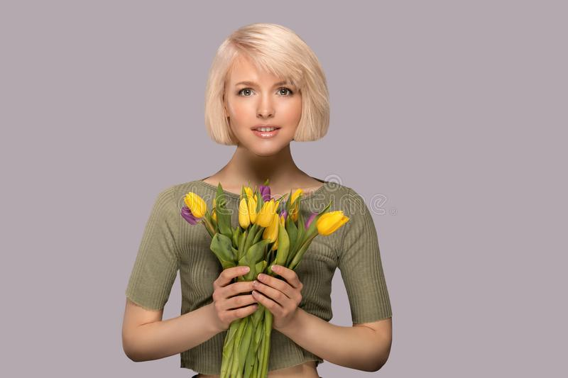 Woman holding a bouquet of tulips stock images
