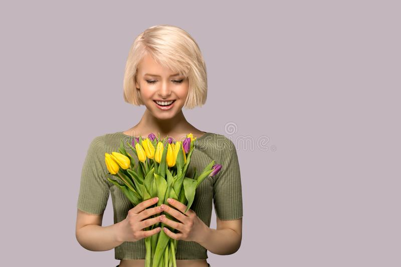 Woman holding a bouquet of tulips royalty free stock images