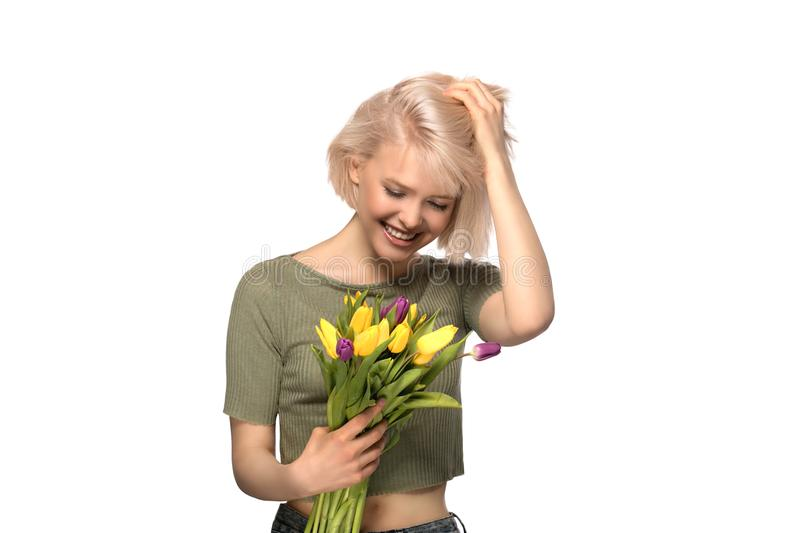 Woman holding a bouquet of tulips royalty free stock photography