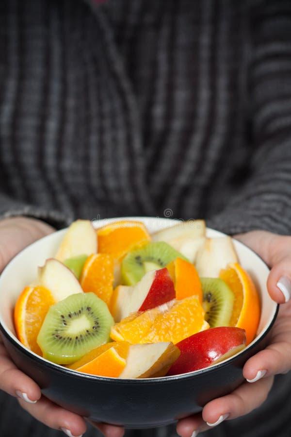Woman Holding Bowl Of Fresh Fruit Stock Photos