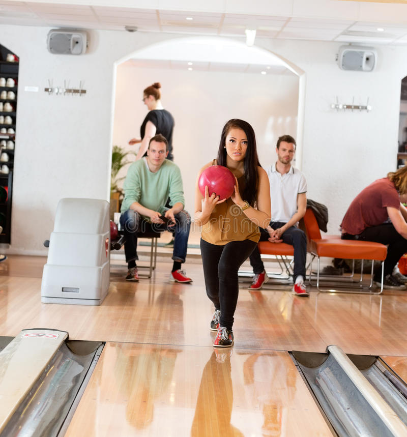 Download Woman Holding Bowling Ball In Club Stock Photo - Image: 37113406