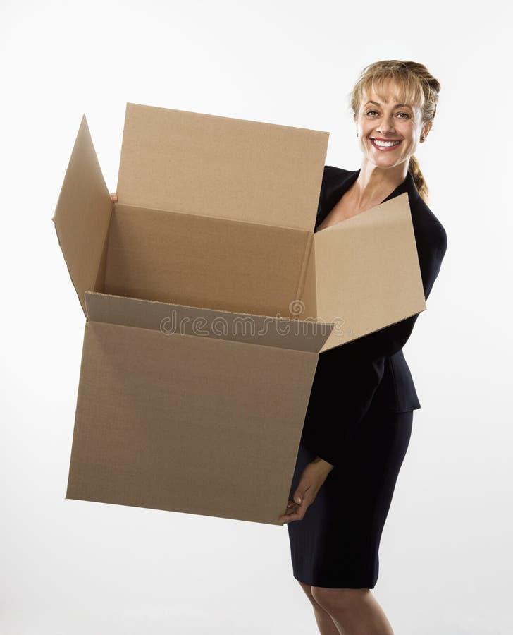 Woman holding box. stock photo