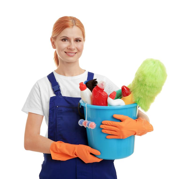 Woman holding bucket with cleaning agents and supplies on background. Woman holding bucket with cleaning agents and supplies on white background royalty free stock image