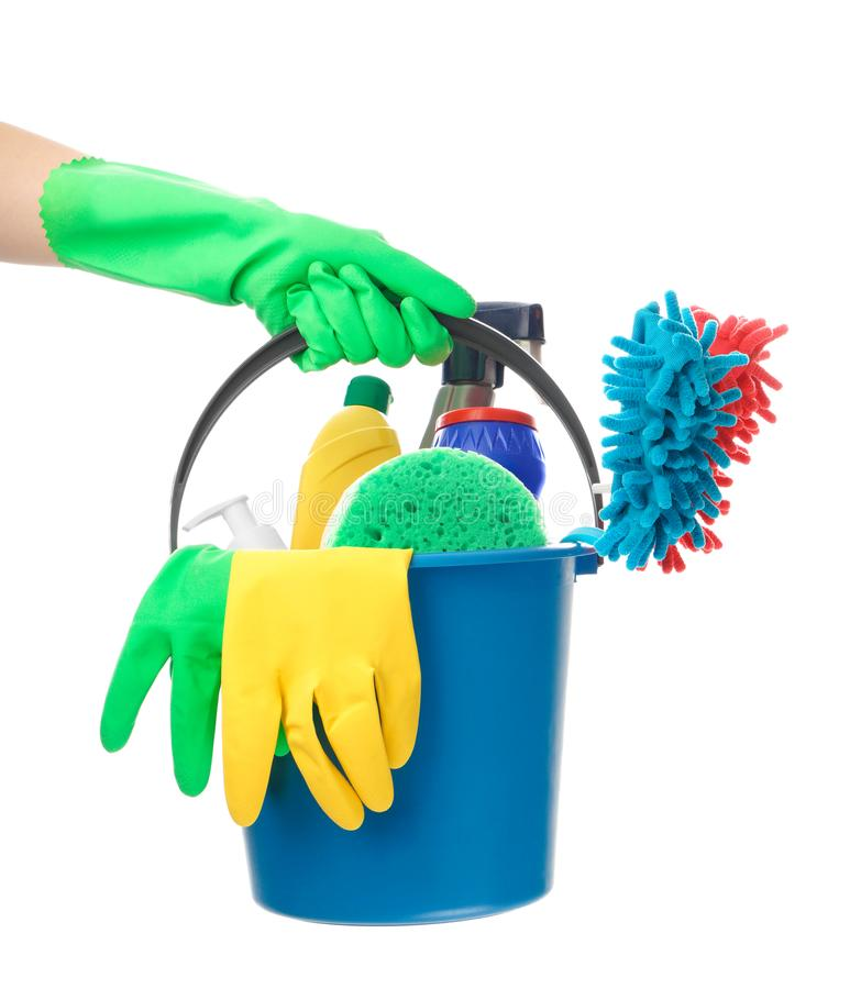 Woman holding bucket with cleaning supplies on white background stock photography