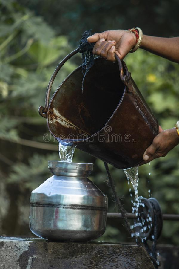 Woman is holding the bucket. stock image