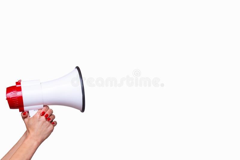 Woman holding a bullhorn or megaphone. Isolated on a white background with copy space in a conceptual image of vocal communication, protest or public speaking royalty free stock image