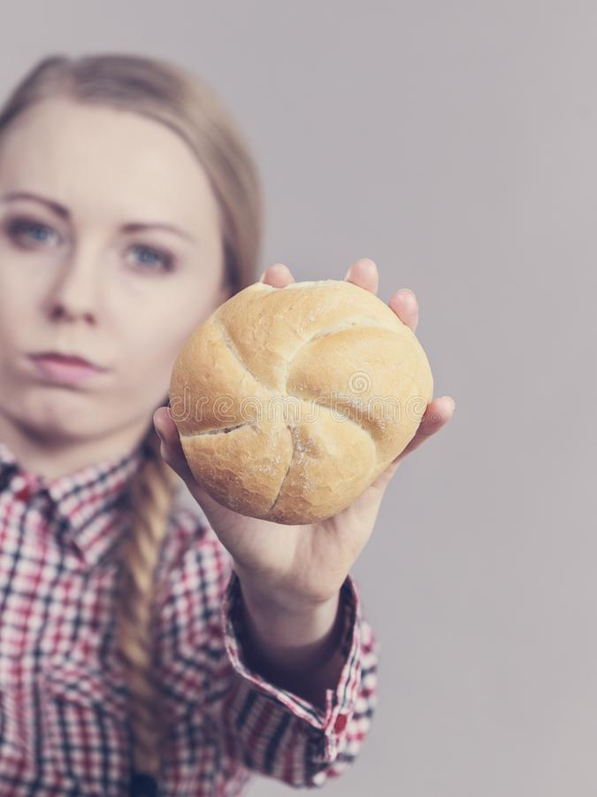 Woman holding bun bread roll stock photo