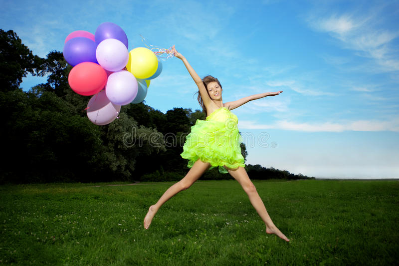Woman Holding Bunch Of Colorful Air Balloons Stock Photography