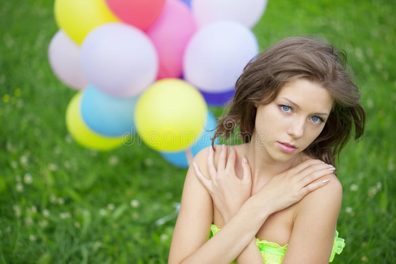 Woman Holding Bunch Of Colorful Air Balloons Royalty Free Stock Photos