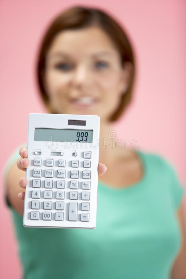 Woman Holding Calculator stock photography