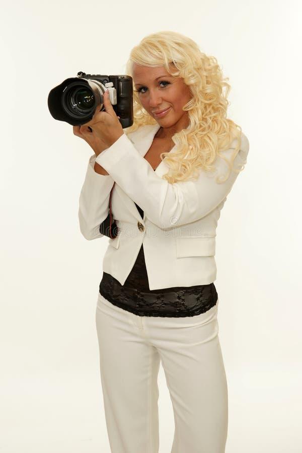 Woman holding camera royalty free stock photo