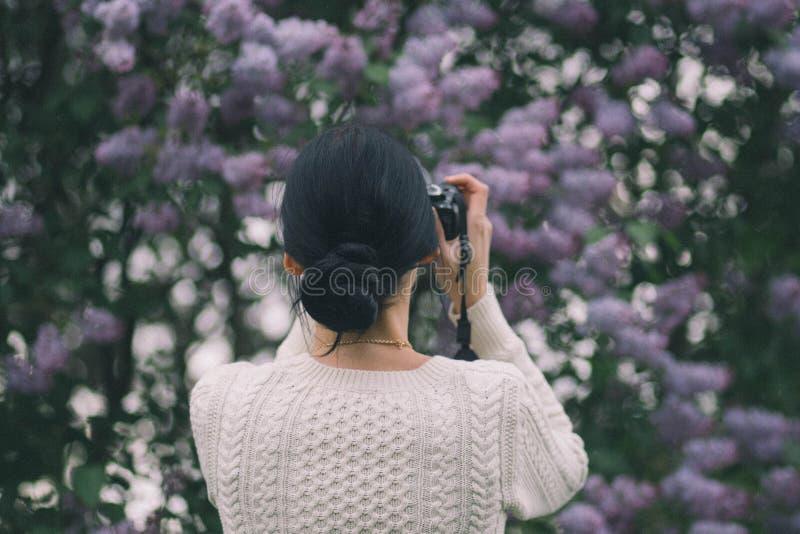 Woman Holding Camera Taking Photos Of Flowers Free Public Domain Cc0 Image