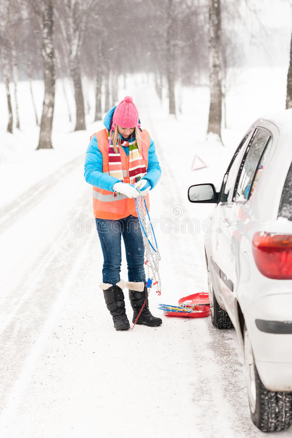 Download Woman Holding Car Chains Winter Tire Snow Stock Image - Image: 27064735