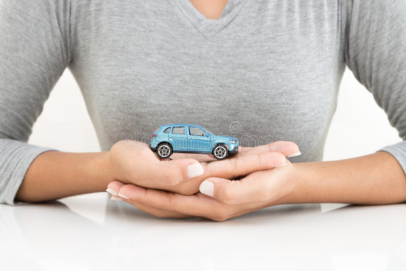 Woman holding car model business concept. Woman holding car model business leasing concept royalty free stock photo