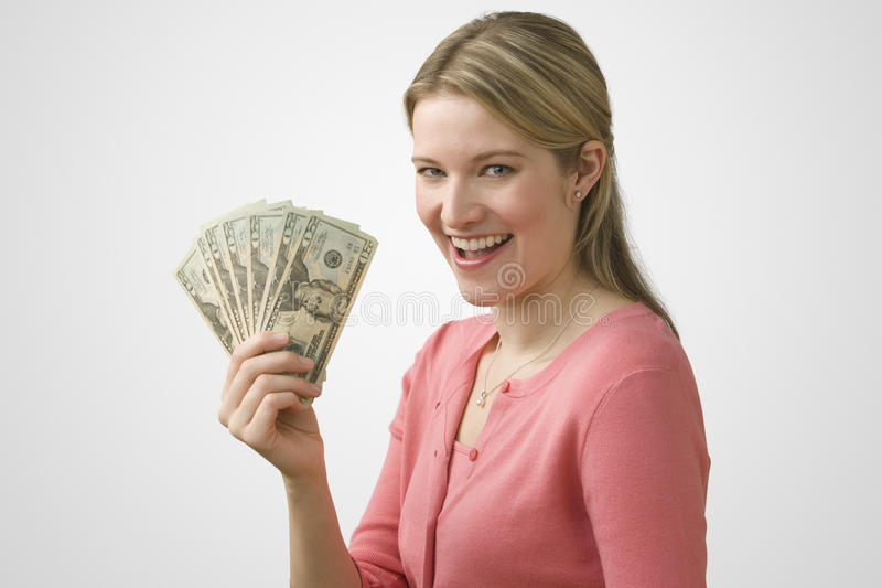 Woman Holding Cash stock images
