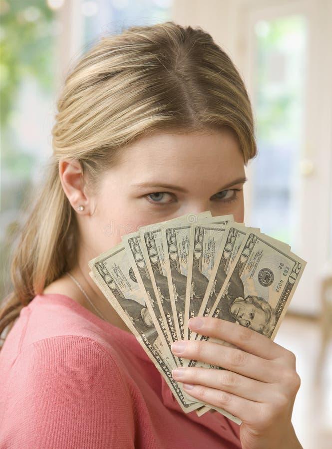 Woman Holding Cash stock photos