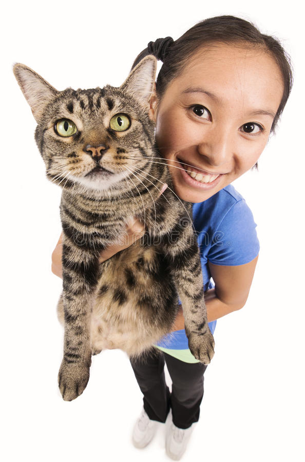 Woman holding a cat stock images