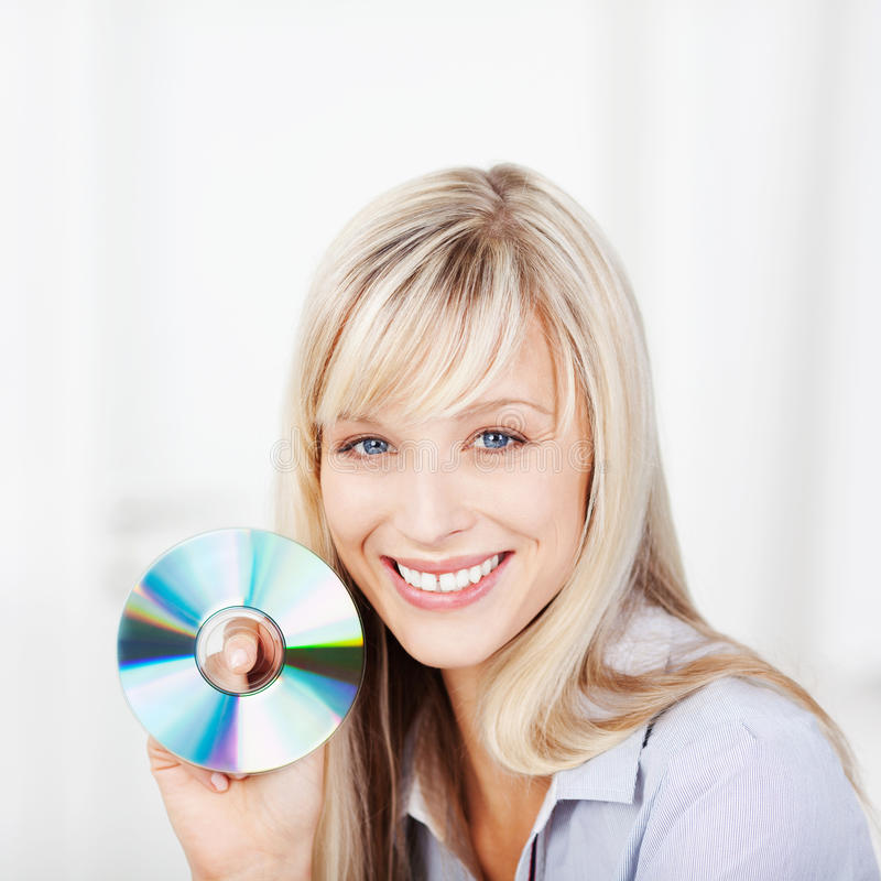 Woman holding cd royalty free stock image