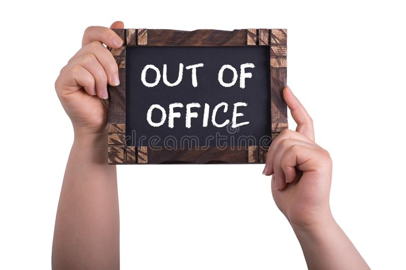 Out of office. A woman holding chalkboard with words out of office isolated on white background royalty free stock image