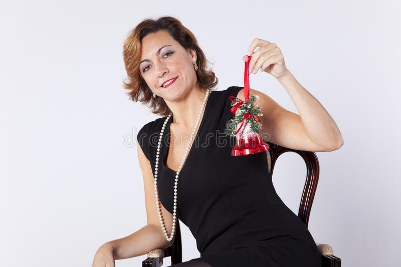 Download Woman Holding Christmas Bell Stock Photography - Image: 28731952