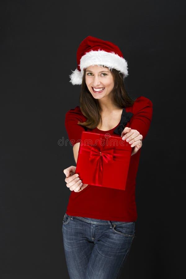 Woman holding christmas gifts stock image