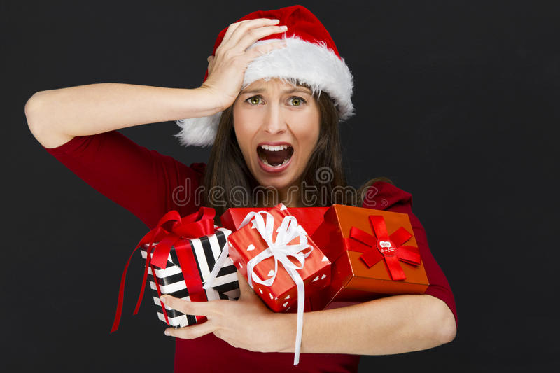 Woman holding christmas gifts royalty free stock photo