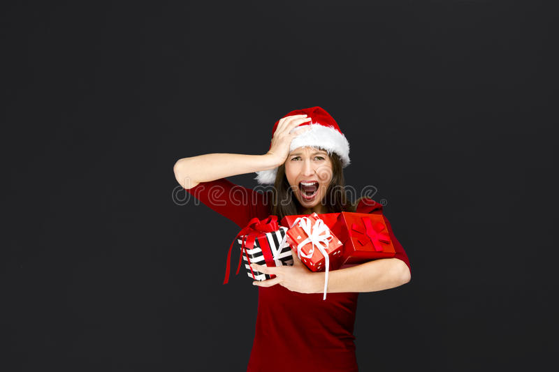 Woman holding christmas gifts stock photos