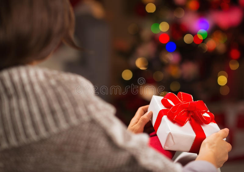 Download Woman Holding Christmas Present Box. Rear View Stock Image - Image of close, space: 28045745