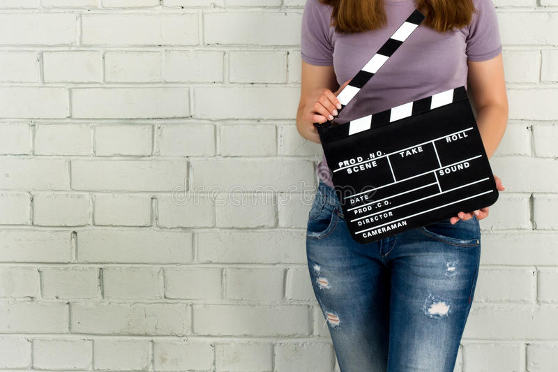 Woman holding a clapboard royalty free stock photos