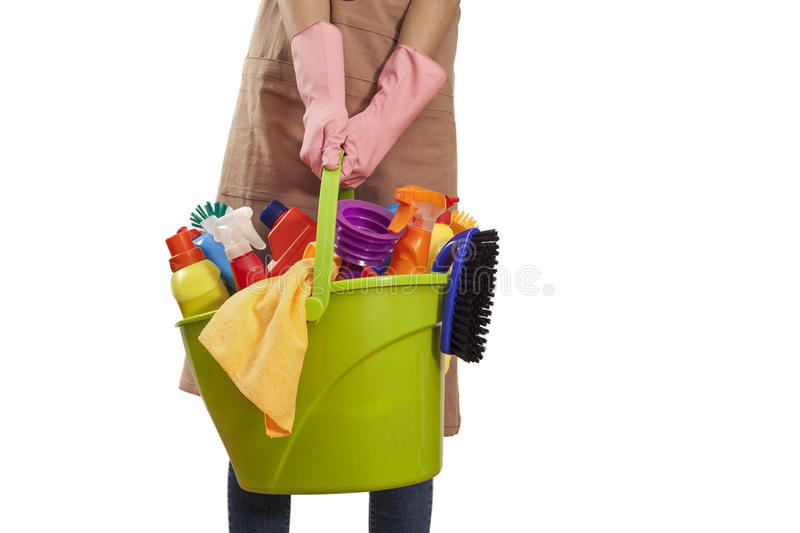 Woman holding cleaning supplies on white background stock photo