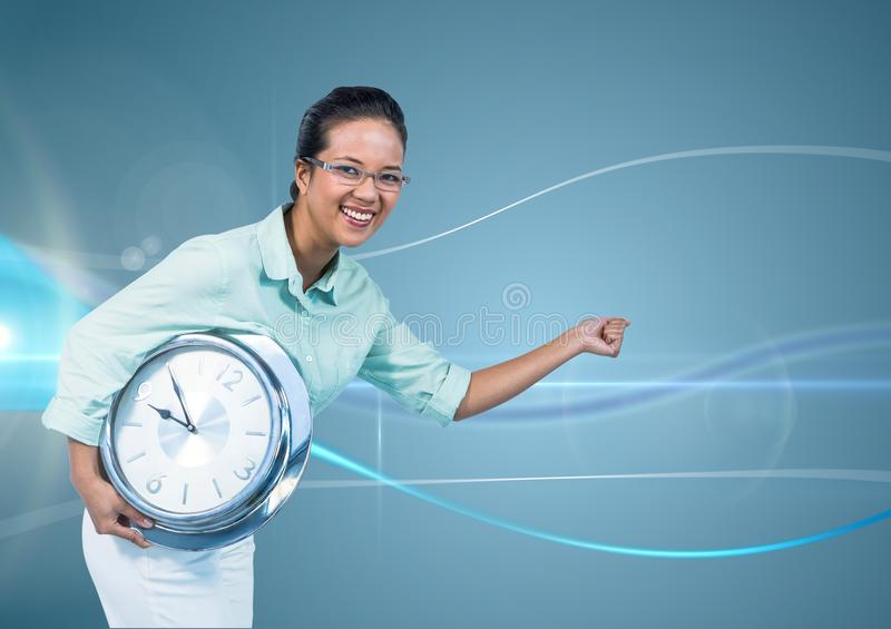 Woman holding clock in front of blue curved background stock photography