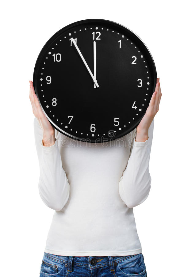 Woman holding a clock over face. Woman holding clock over face isolated on white background. Woman schedule concept royalty free stock photo