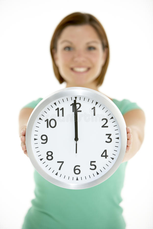 Download Woman Holding Clock Showing 12 O'Clock Stock Photo - Image: 10001112
