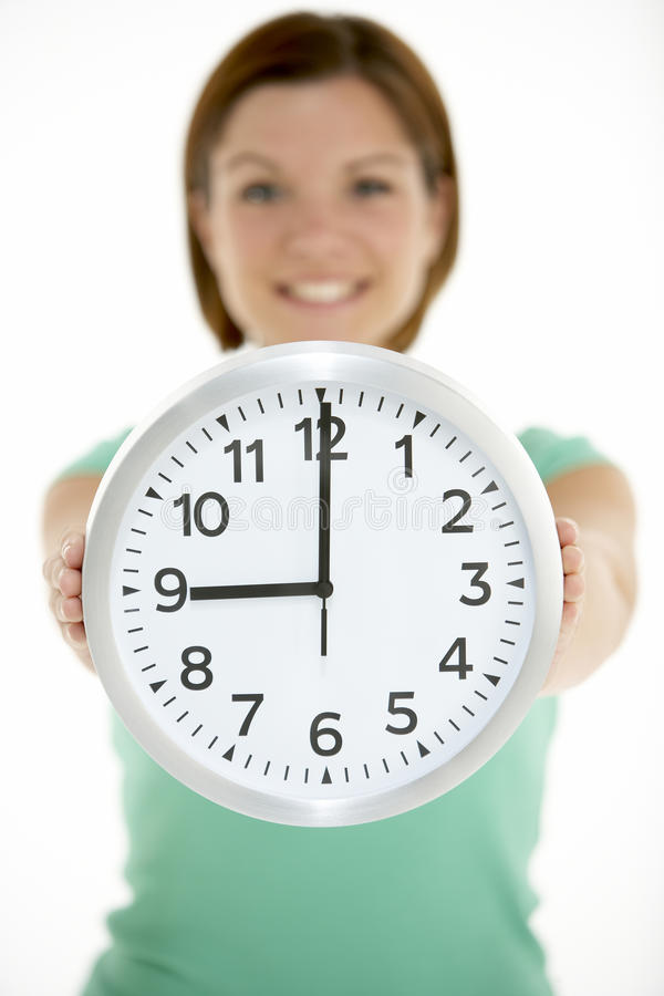 Woman Holding Clock Showing 9 O Clock