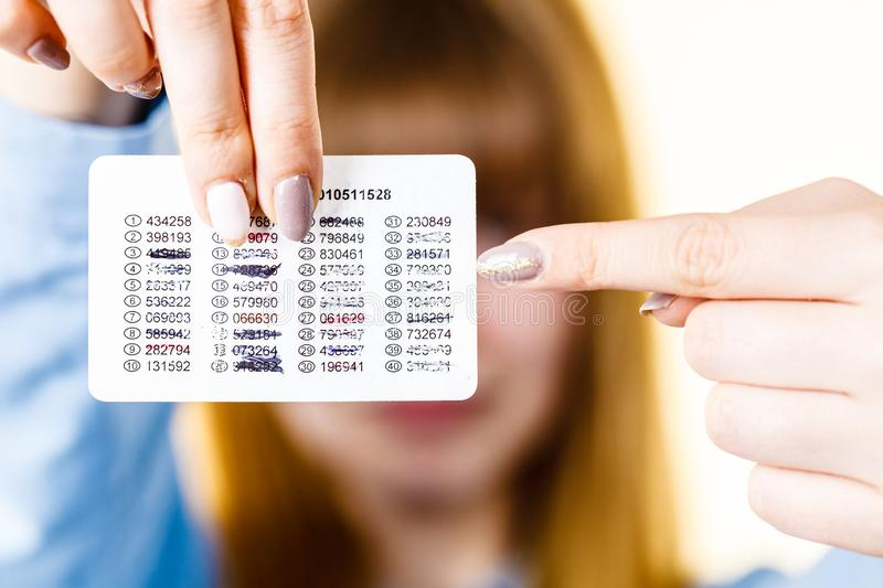 Woman holding codes for online transfers royalty free stock photography