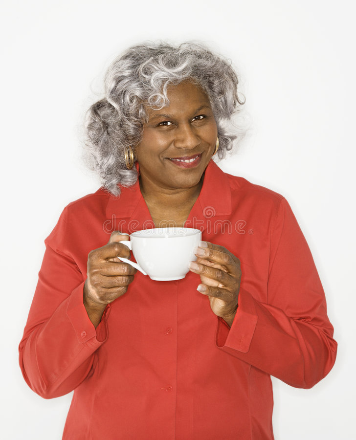 Woman holding coffee cup. stock image